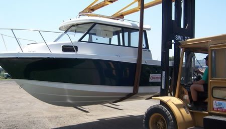 Boat Terminal Transport & Storage - Loading a new boat for delivery